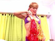 Pigtailed redhead shemale cheerleader Melina dancing and showing off her small tits