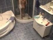 Sweet brunette young voyeur babe Lilia undressing in bathroom